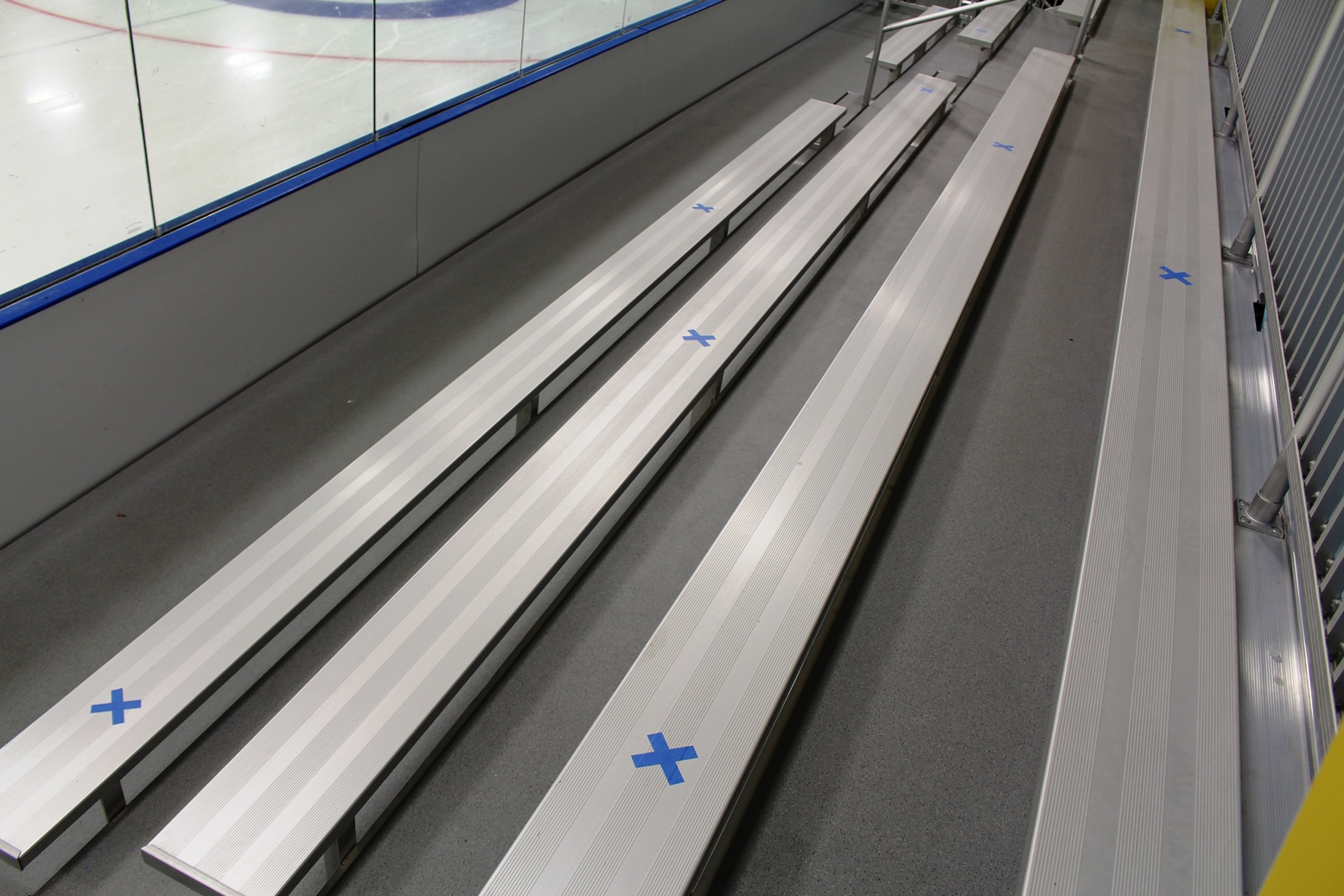 bleachers marked with tape for social distancing